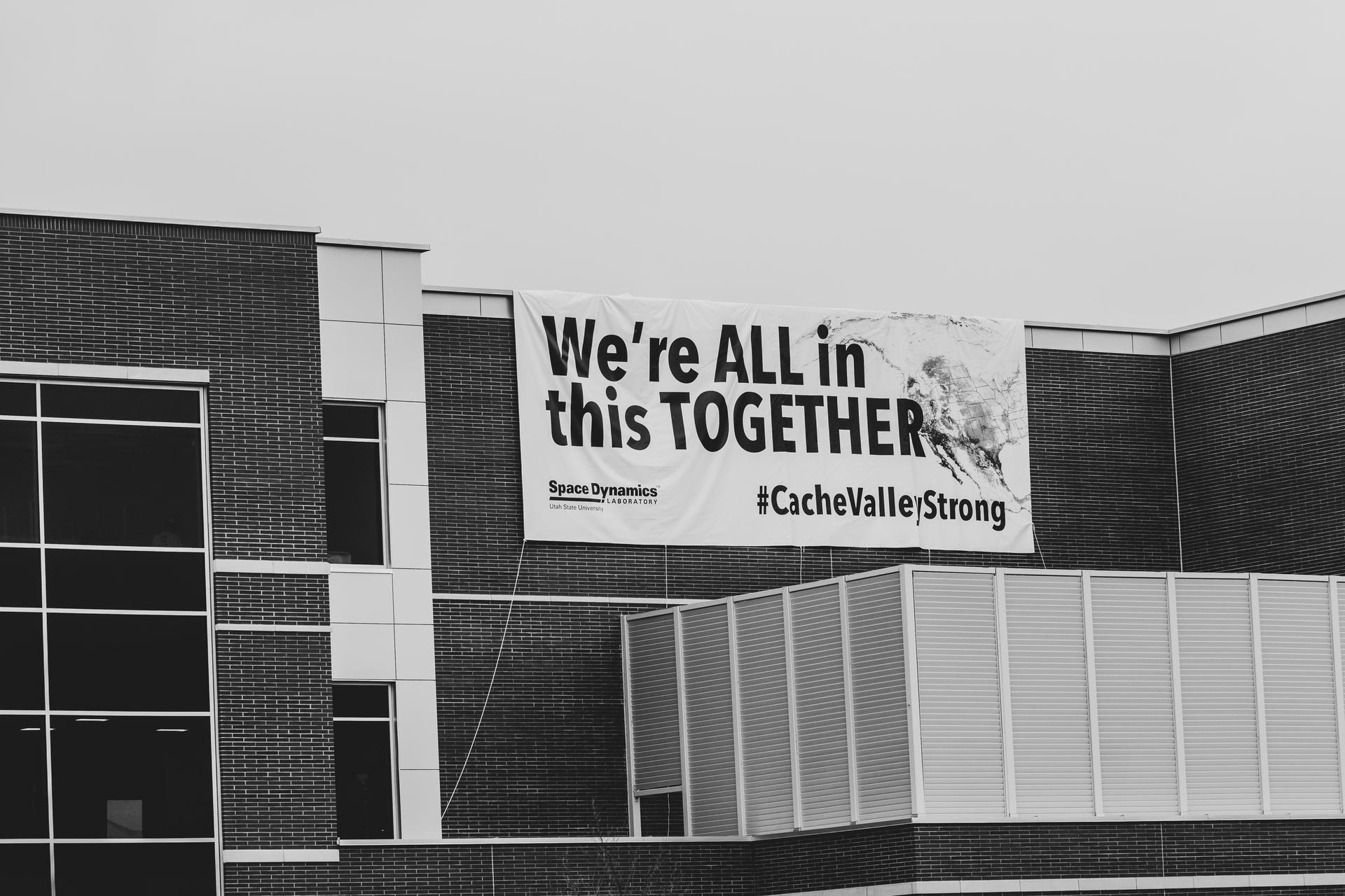 "Giant sign that ""We're all in this together."""