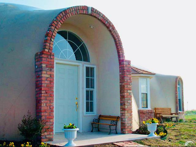 A beautiful arched entrance to a Monolithic Dome Home