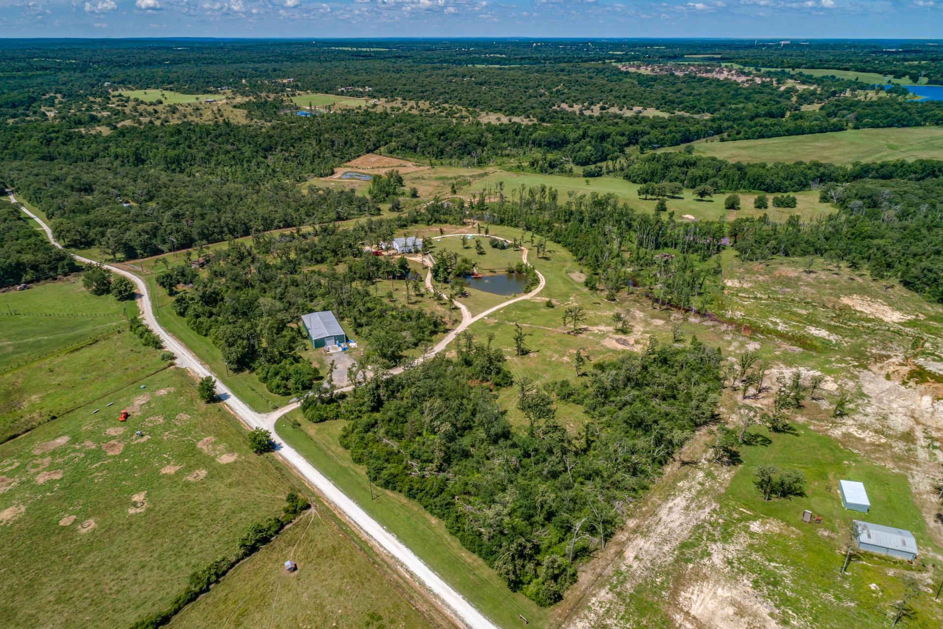 The sprawling 40-acre homesite showing the ponds, garage, warehouses, and outbuilding on the property.